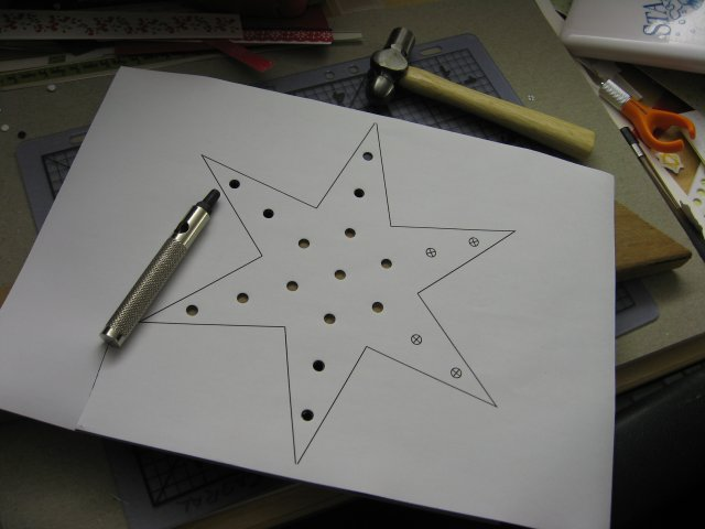 Punching the LED holes in the Christmas Star.