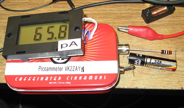 Picoammeter measuring a 23 Gig resistor using a 1.3 volt bias from a dead AAA battery cell.