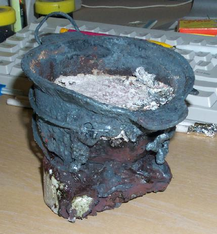 melted crucible fused to vitrified plinth